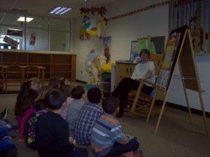 READING Annie to first graders at elementary school