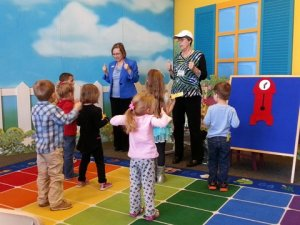 """Singing """"Our Thumbs Up"""" song at Rockwall Library."""