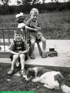 1950 Clarike in playpen grabbing brother Ernst  with Brother John sitting with dog Peiter.