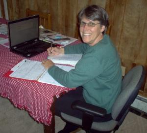 Me,Clara, writing at table